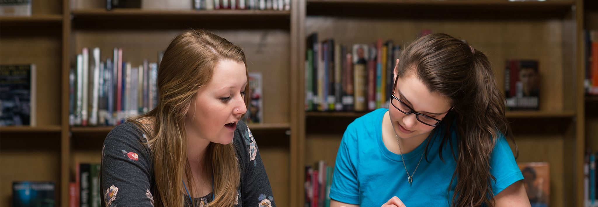 Students working on homework together in the CCU library.