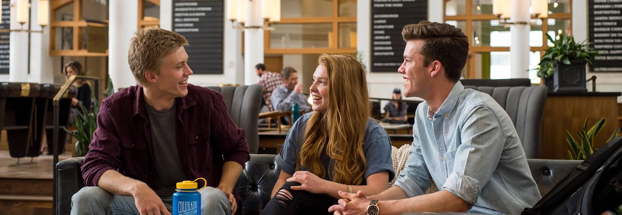Colorado Christian University students talking in Denver.