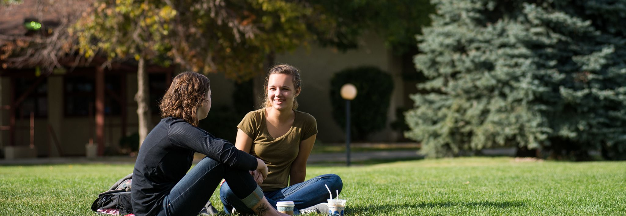 College students sitting outside on CCU's lawn.