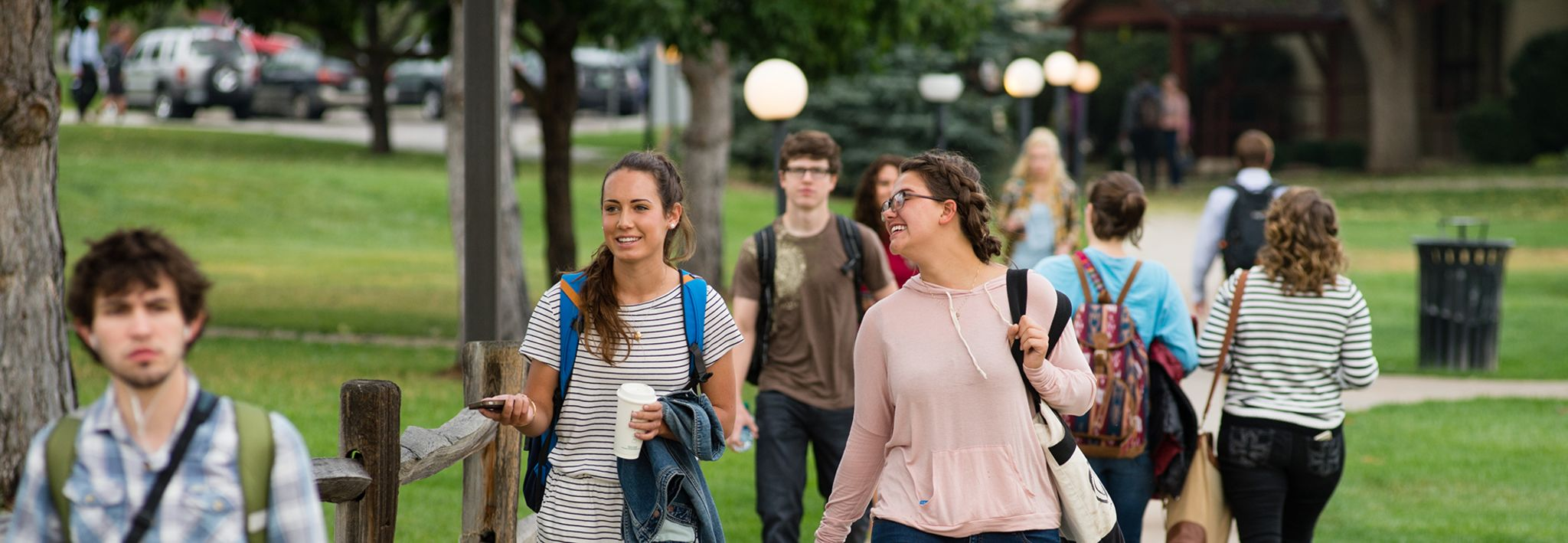 CCU students walking on a path through campus.