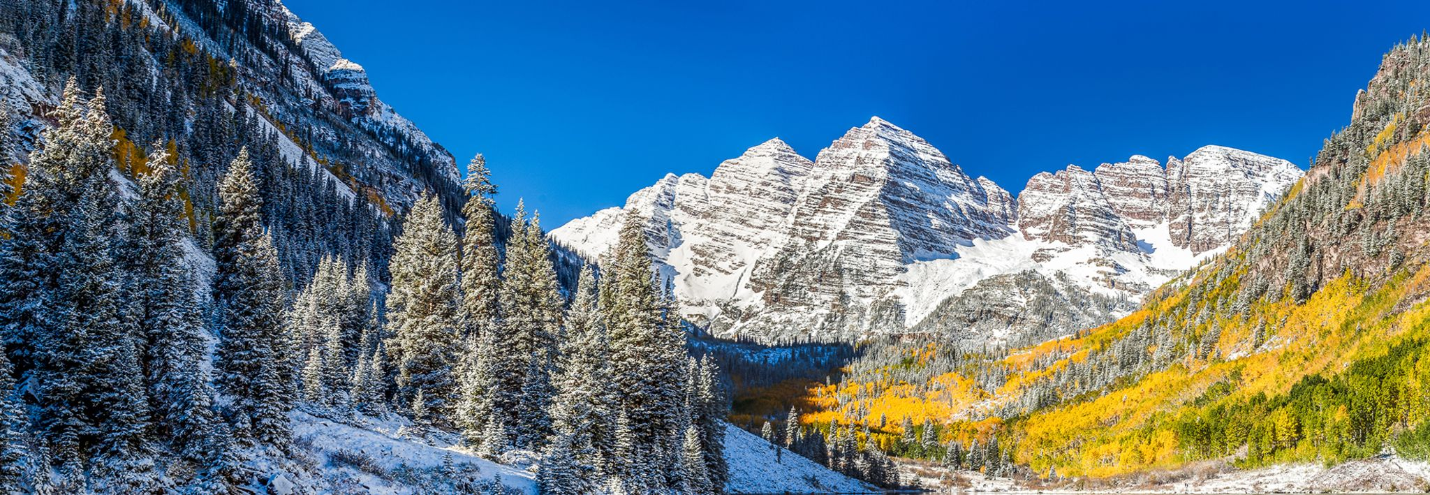 Fall and winter collide in this outstanding picture of the Maroon Bells, located in Colorado.
