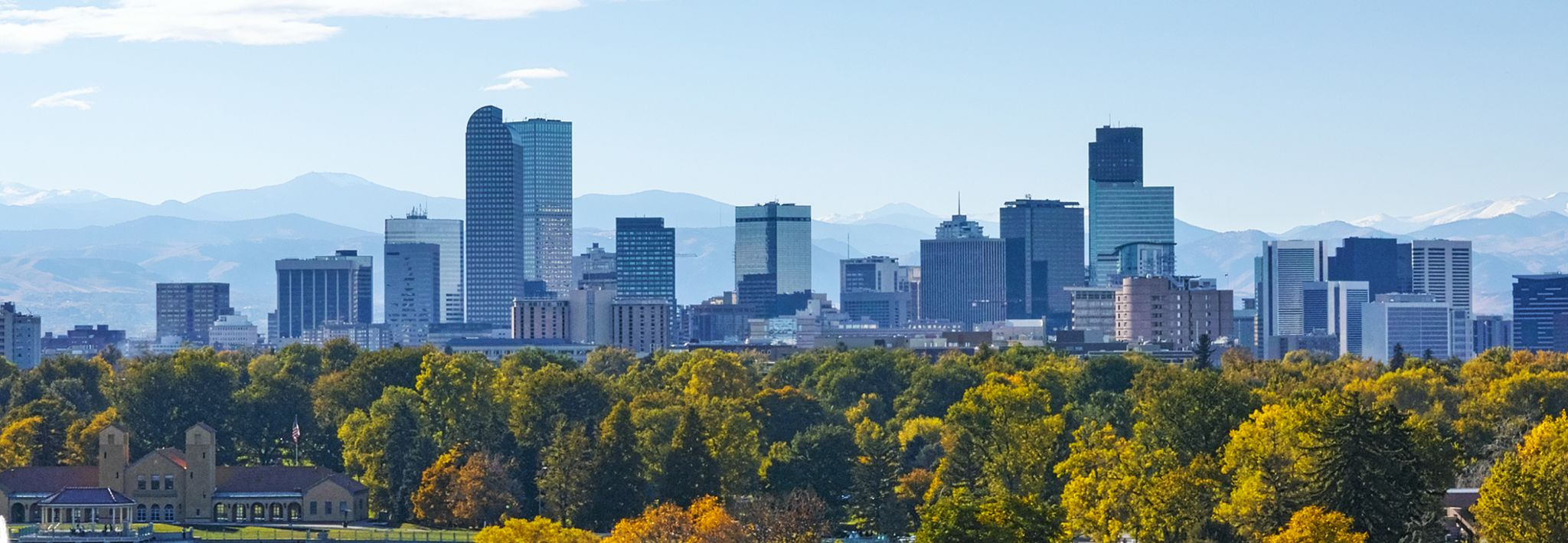 Denver skyline with the trees and mountains.