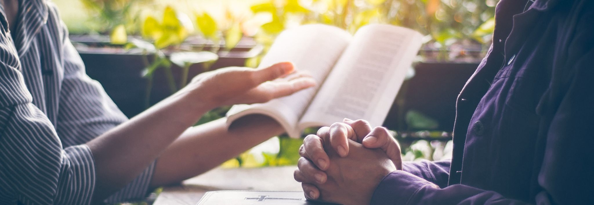 A person teaching his friend about the Bible.