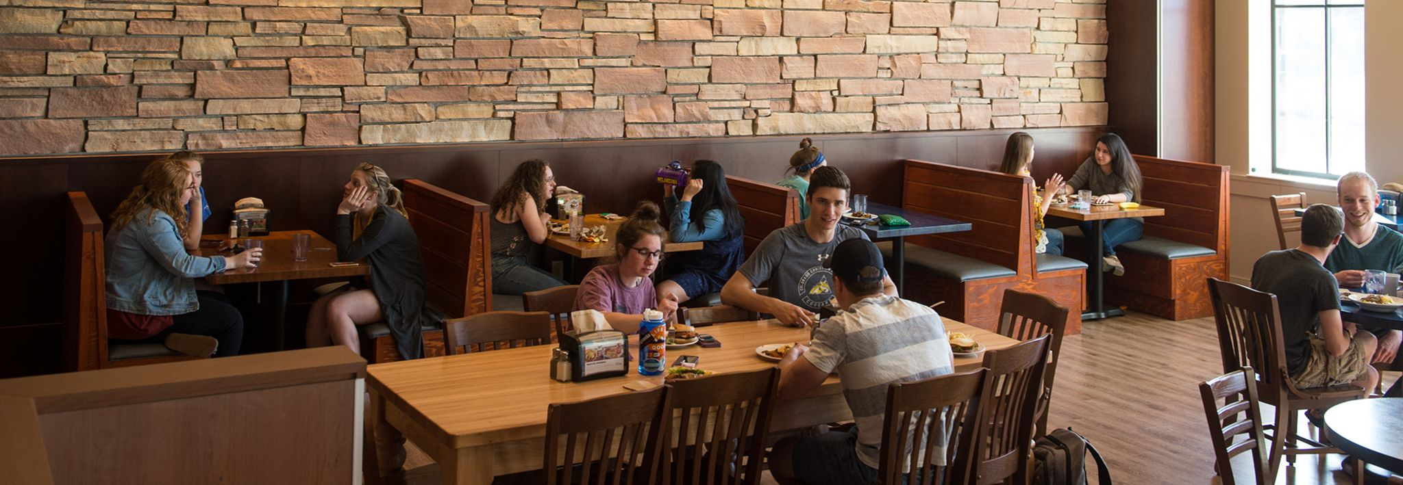 CCU students eating in the dining hall.