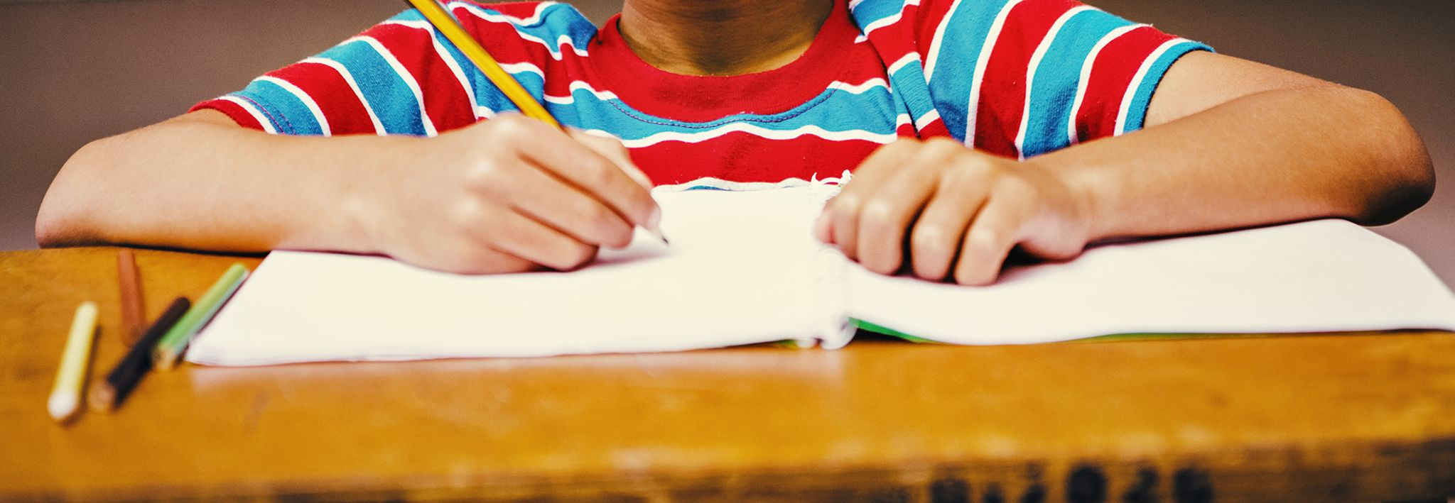 A child writing in his school notebook.
