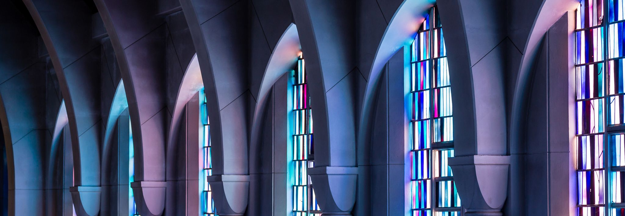 Church has purple and blue stained glass.