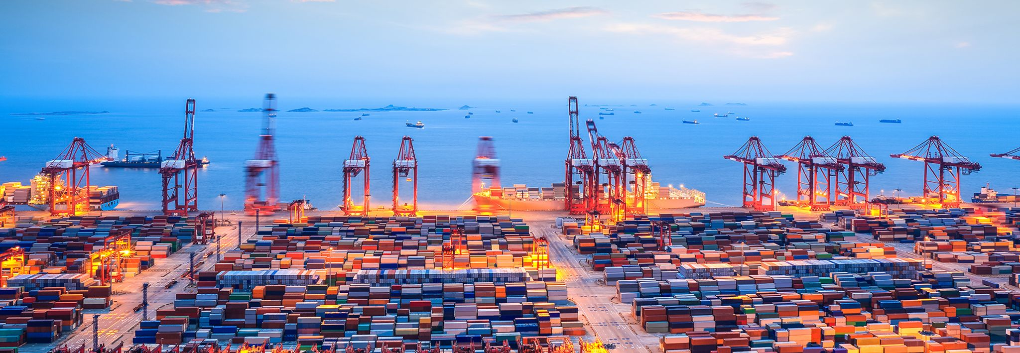 International shipping yard at dusk.
