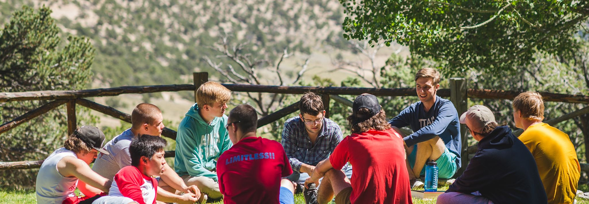 CCU students talking on a camping trip.