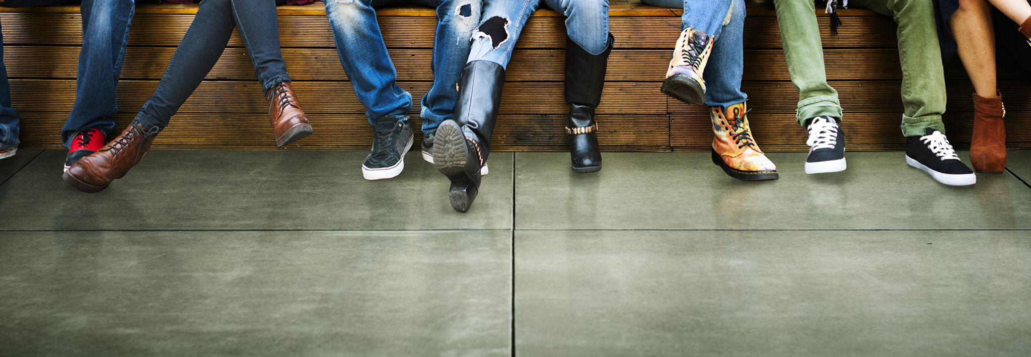 Photo of teens pose with their stylish shoes.
