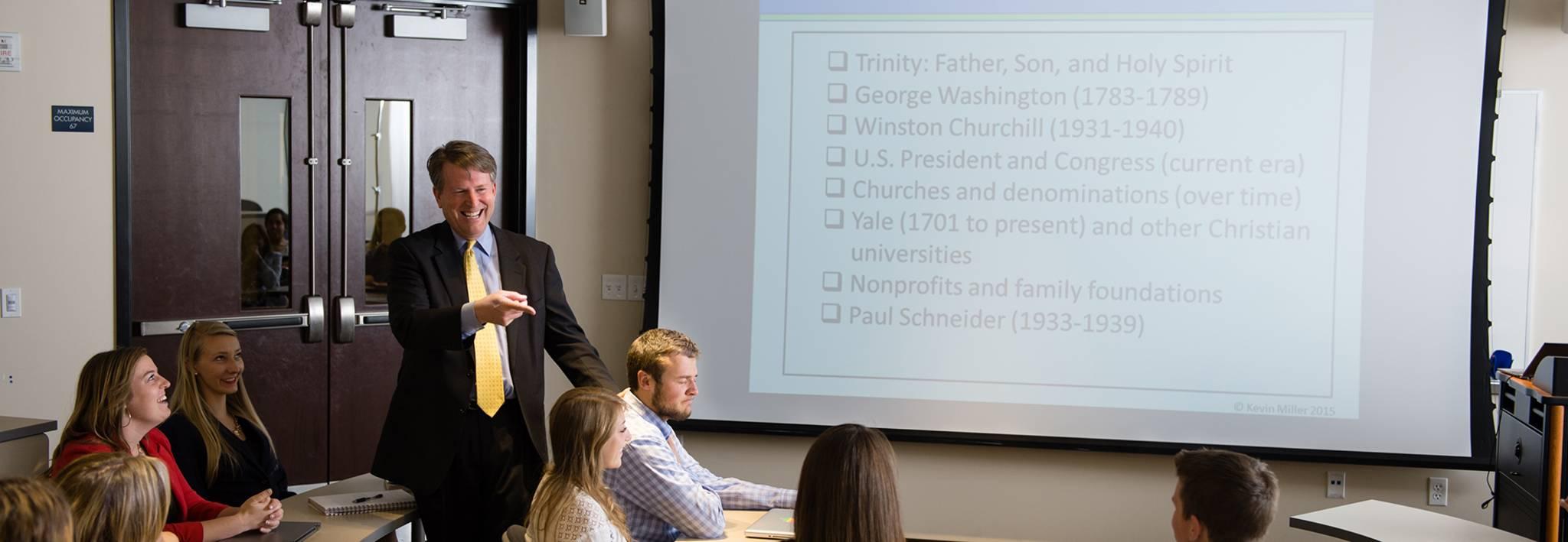 CCU Professor Miller teaching a business class.