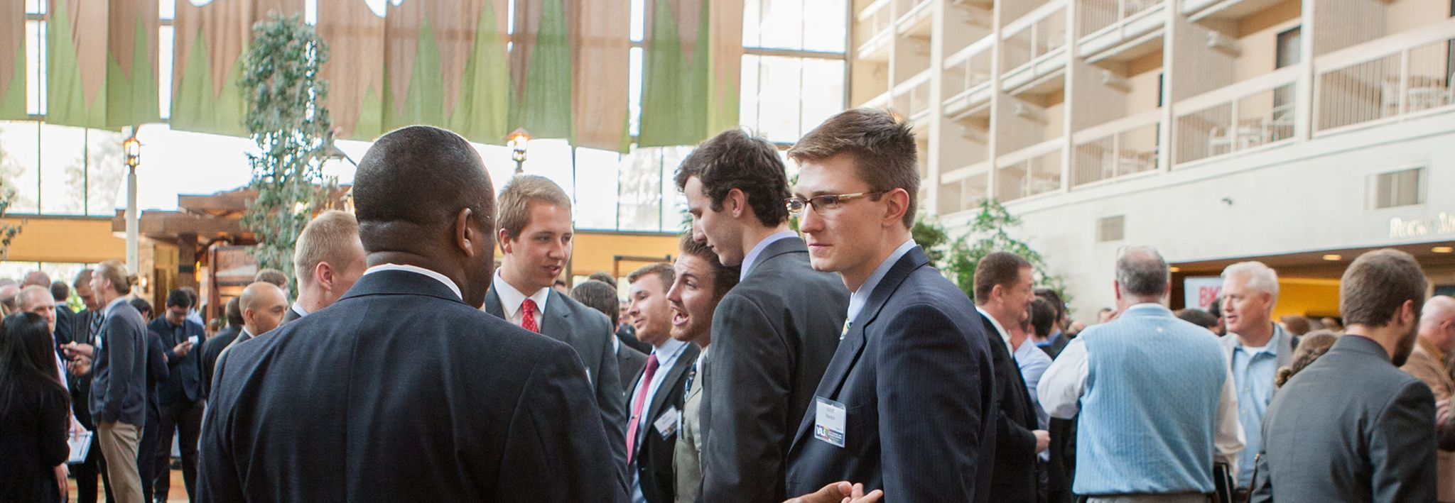 CCU student networking with a business professional at VALS event.