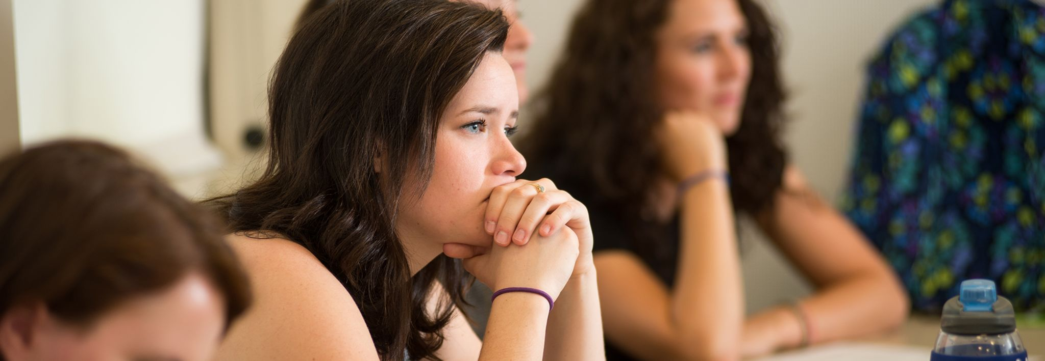 A CCU student sitting in a theology class.