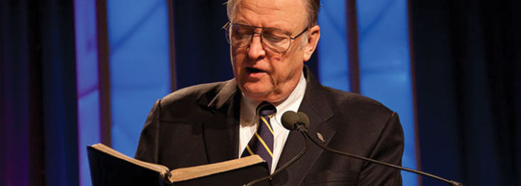 Bill Armstrong reading from the Bible