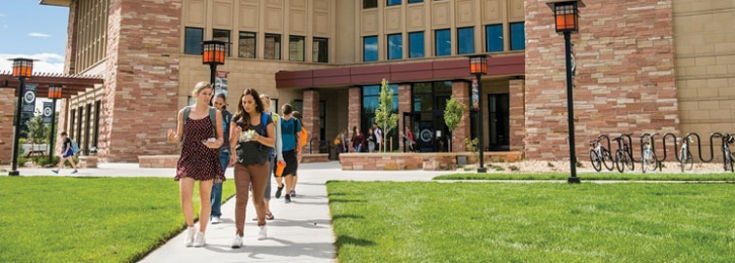A group of students are walking to class on the CCU campus.