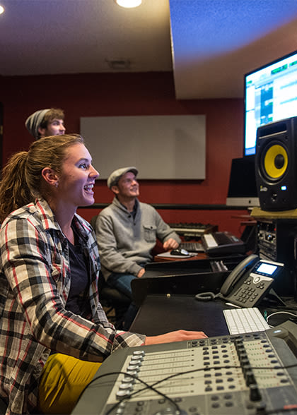 students using music production technology