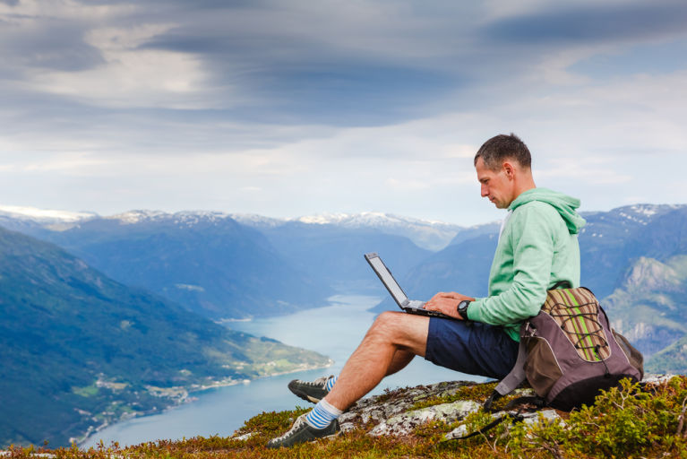 A man is working remotely while on vacation.