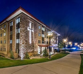 CCU's Yetter Hall academics building lit up at night