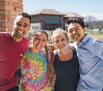 diverse students smiling on CCU campus
