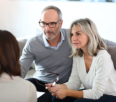 Couple discussing with financial planner