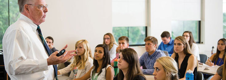Students are sitting in class on the Colorado Christian University campus.
