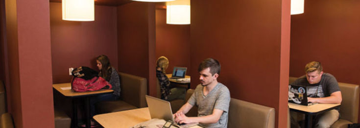 A group of students is studying in the cafe at Colorado Christian University.