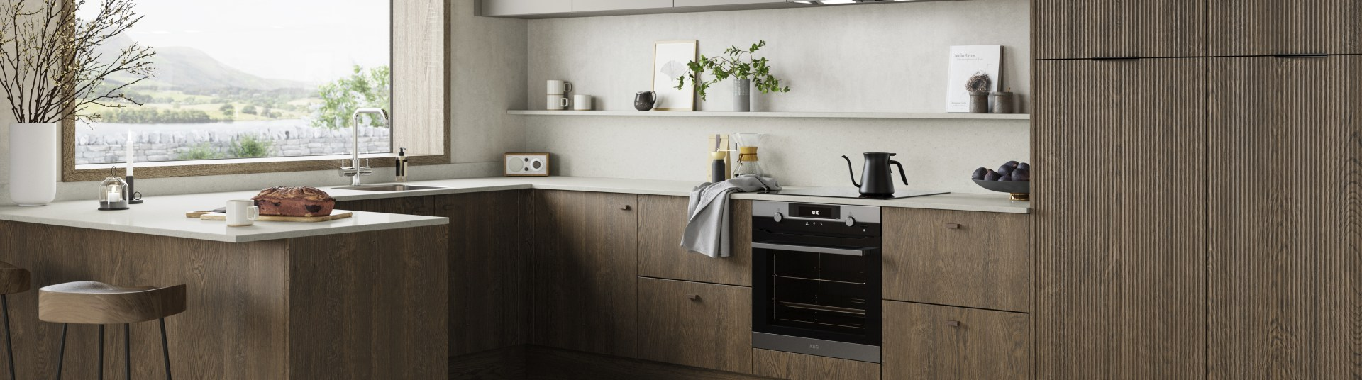 Magnet Kitchens 2021 Nordic Nature range with Fluted oak doors and Integra Hoxton Pebble cabinets with Dekton Aeri worktop. U-shaped kitchen with breakfast bar area.