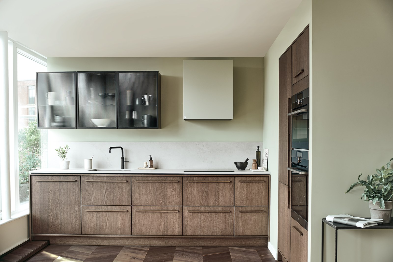 Magnet Kitchens 2021 Nordic Nature range with Fluted oak doors and Integra Hoxton Pebble cabinets with Dekton Aeri worktop.