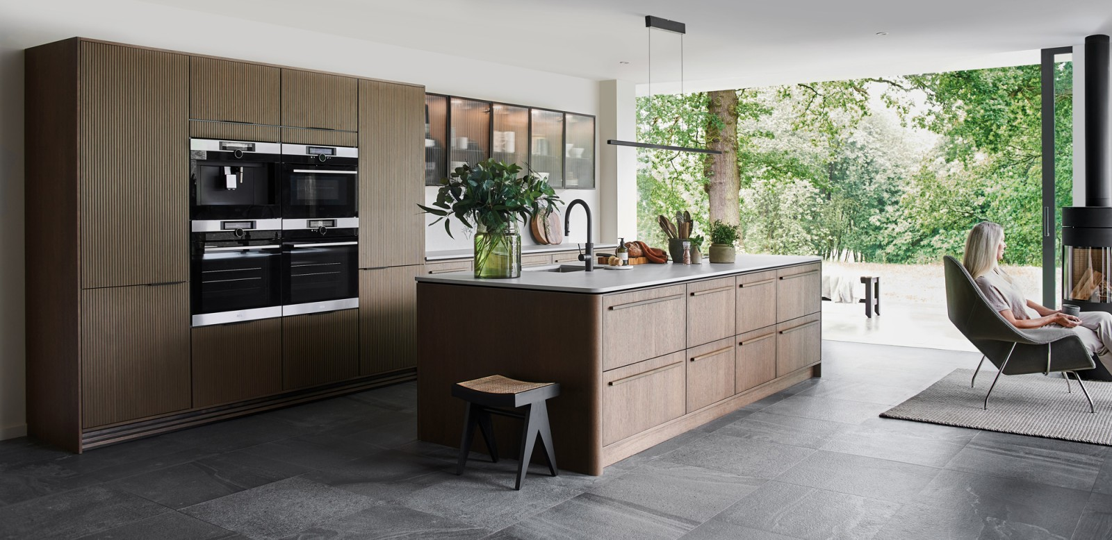 Nordic Nature. Modern wooden kitchen design with a Nordic influence. Featured floating worktops, a ribbed plinth and rounded end panels