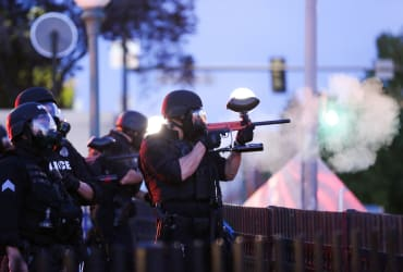 Two Denver police officers suspended for using violence on nonviolent people during protests against police violence