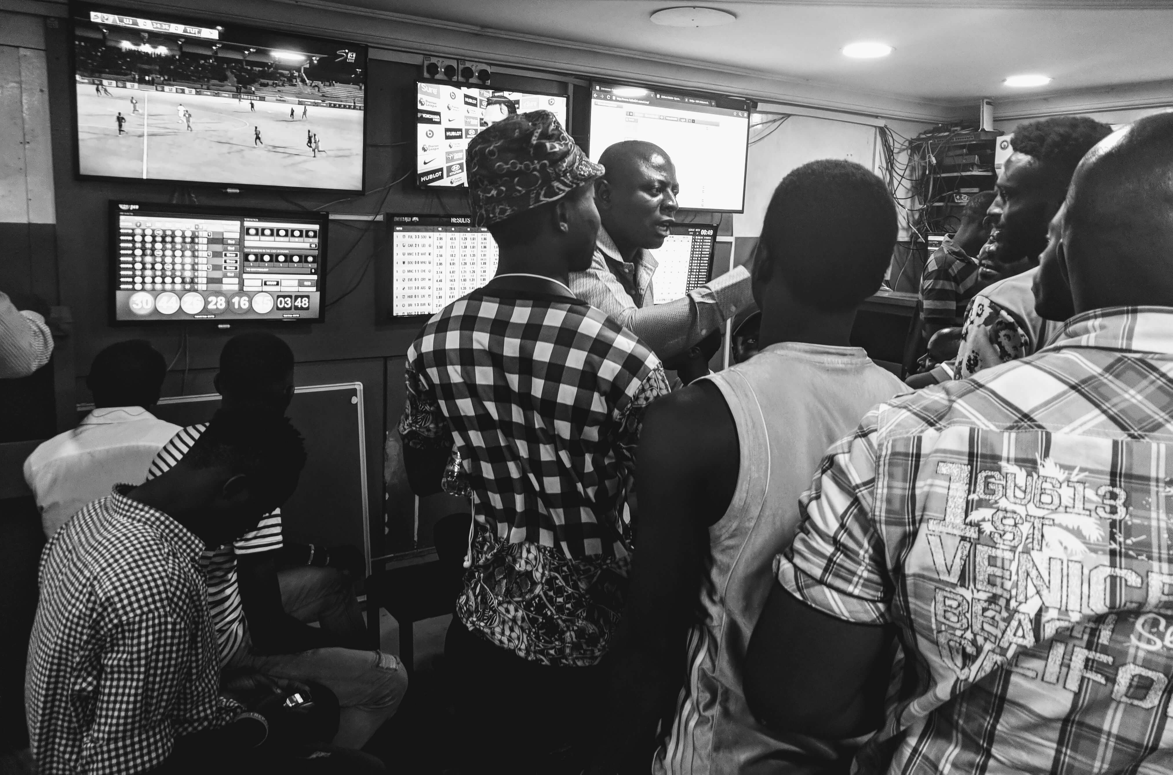 Bettors in a betting shop in Lagos, Nigeria