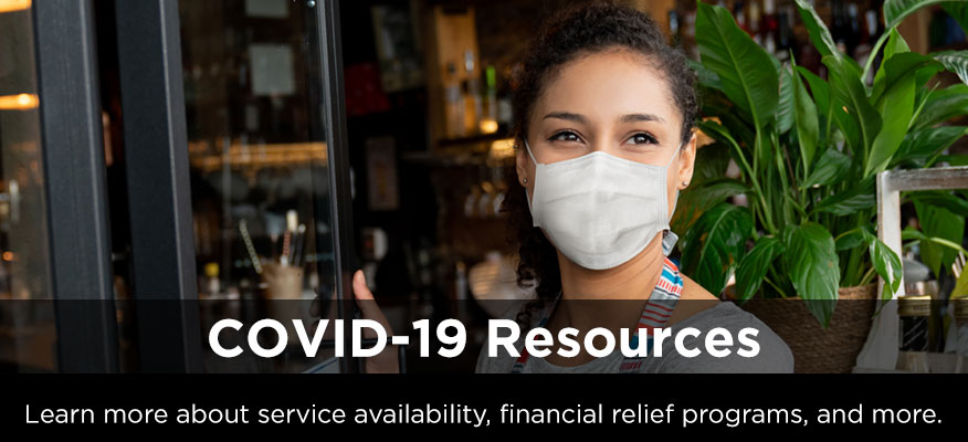 woman with mask in front of a build - heading 'COVID-19 Resources' and description 'Learn more about service availability, financial relief programs, and more'