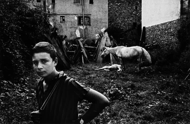Black and white photo of Gabriel Cuallado, entitled Gabriel with White Horse (Family)