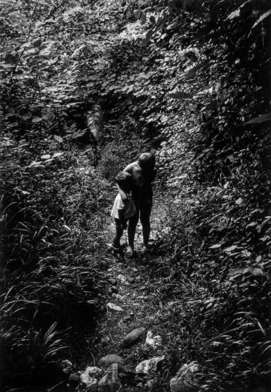 Black and white photo of Gabriel Cuallado, entitled Boys in the path (Family)