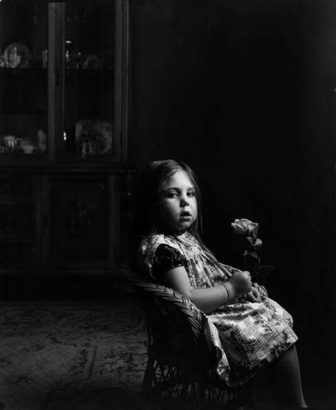 Black and white photo of Gabriel Cuallado, entitled Girl with rose (Family)