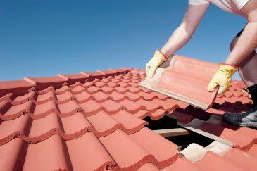 Builder doing roof repairs