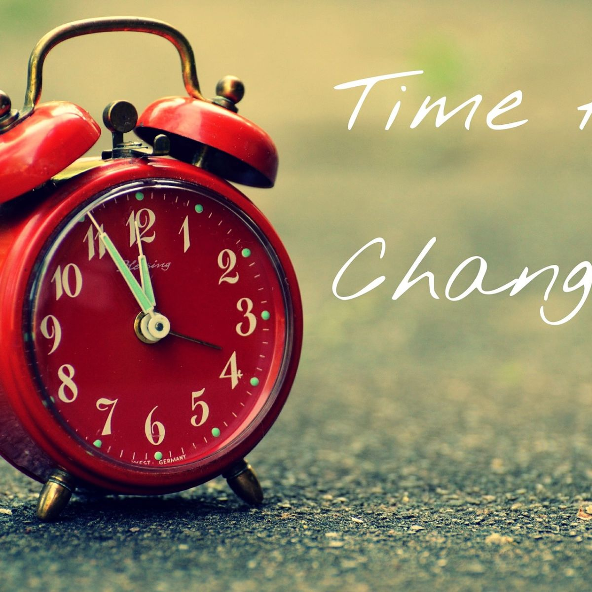 Red alarm clock: Time for change