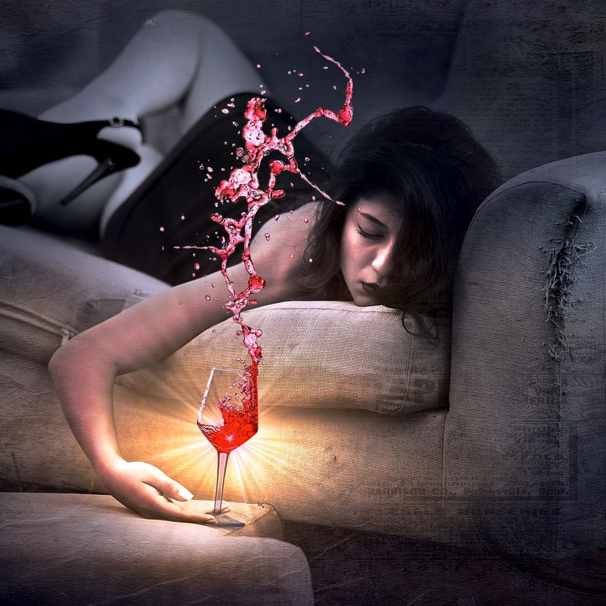 Woman on couch drinking red wine