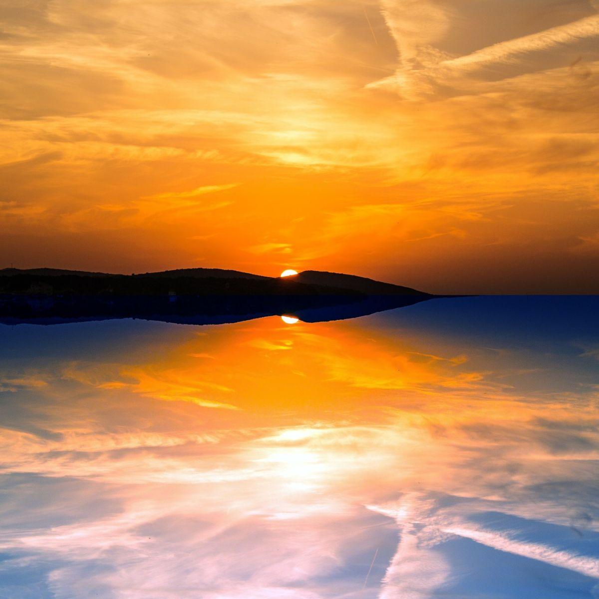 Evening reflections on sunset on lake