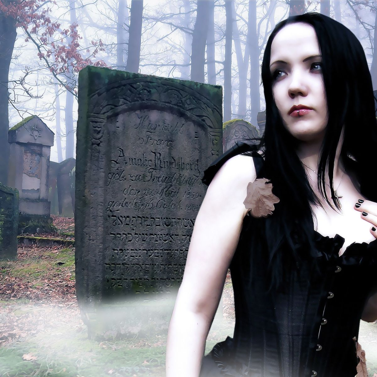 Gothic black model on cemetery with gravestones