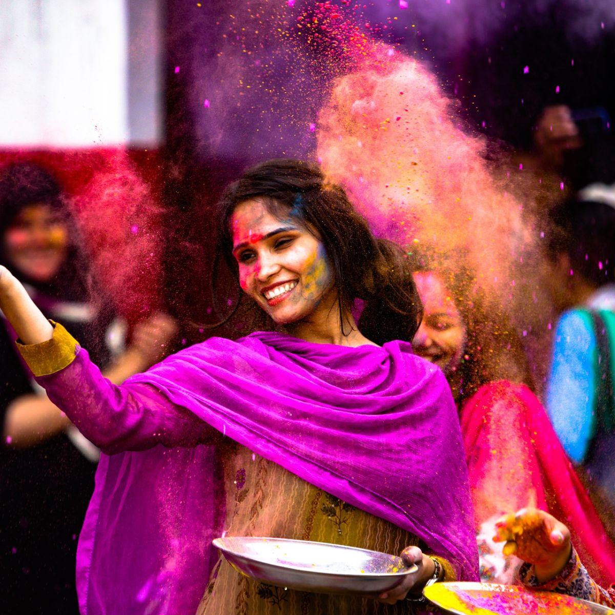 Indian girl full of color at Holi festival