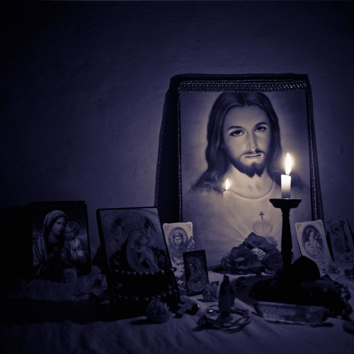 Jesus christ on a picture with candlelight