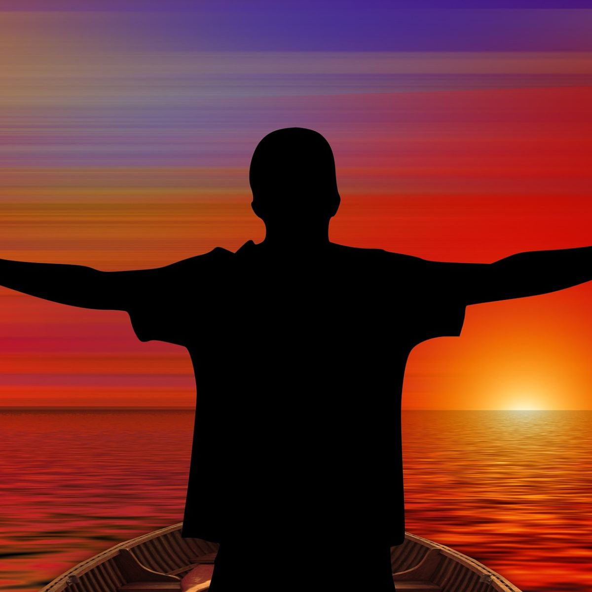 Man on boat welcoming sunrise with open arms
