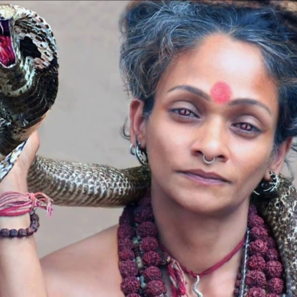 Sheila Chandra with cobra, portrait