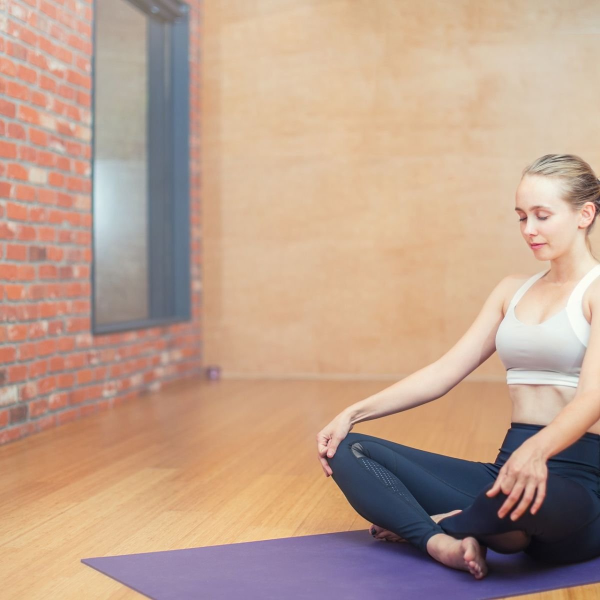 Woman on yoga mat. Meditating.