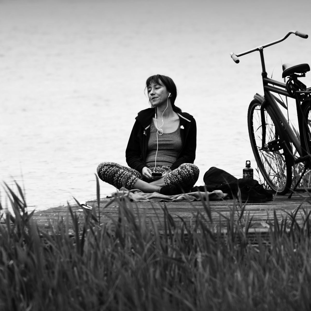 Woman: Meditation at the lake with bicycle