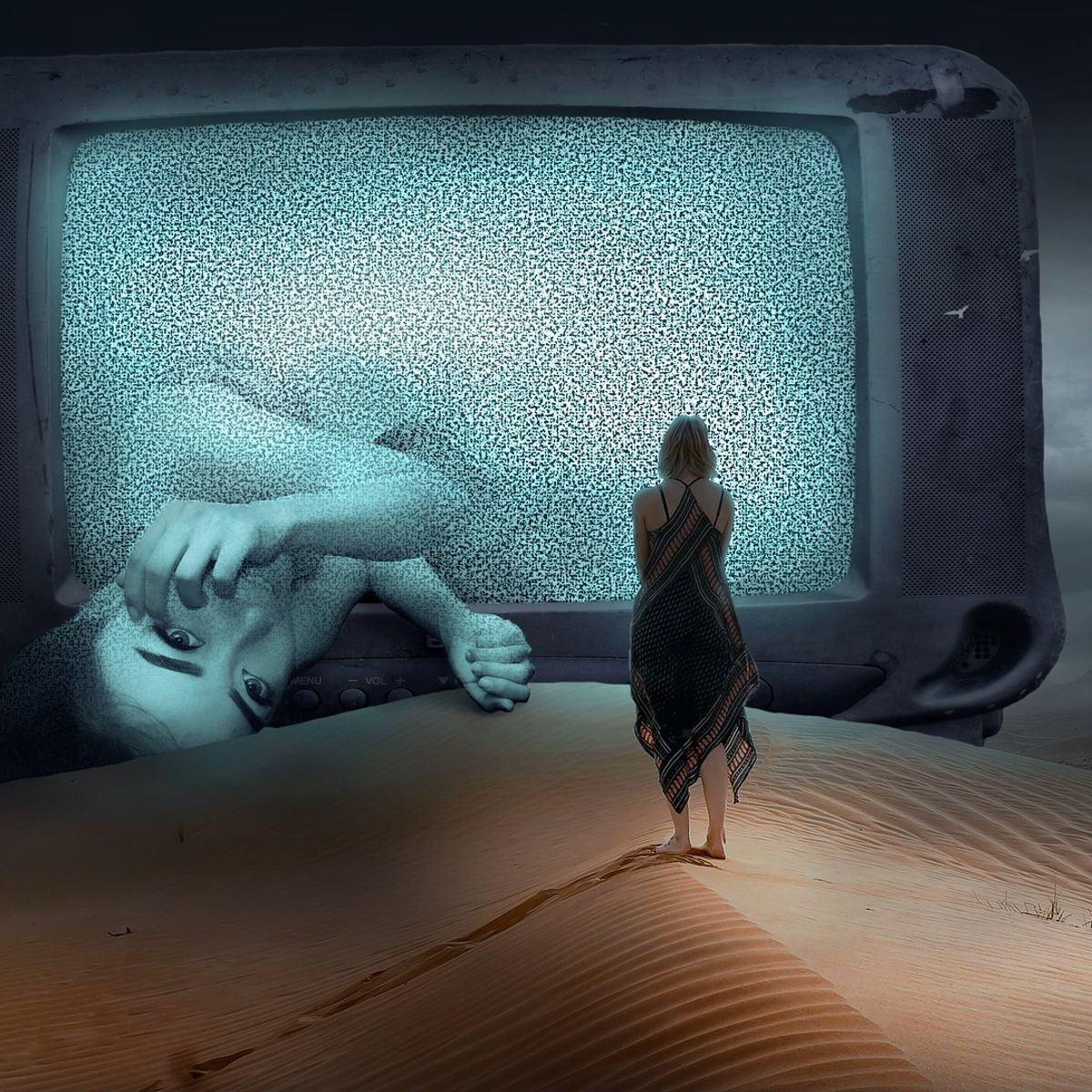 Dreamy scence: Woman walking on desert-sand into huge TV