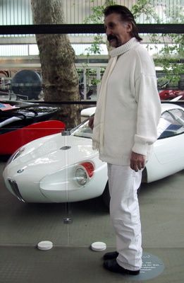 Luigi Colani (Designer of biomorphic vehicles) in front of is BMW 700 car