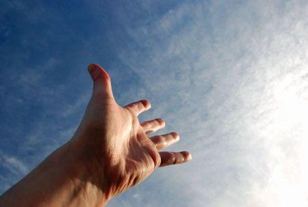 Hand into open sky