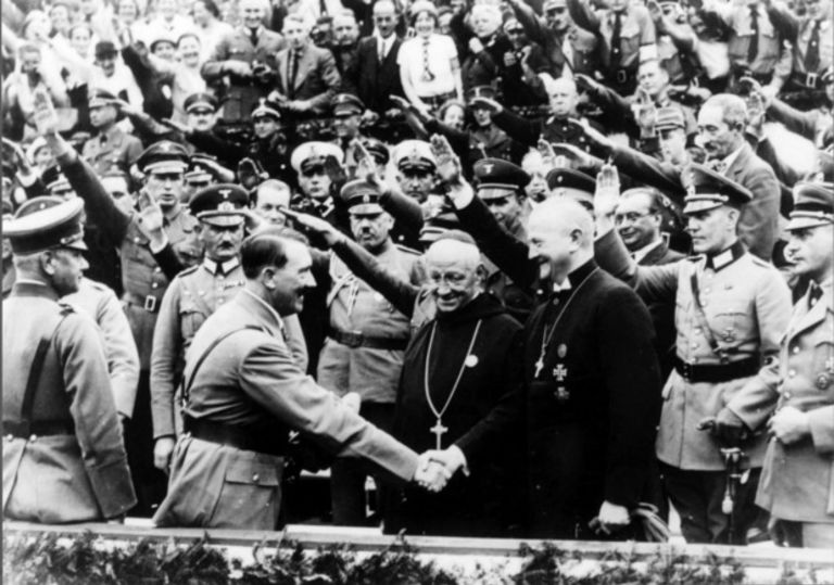 Dictator Adolf Hitler shaking hands with catholic dignitaries, priests, pope, christianity, 3rd reich