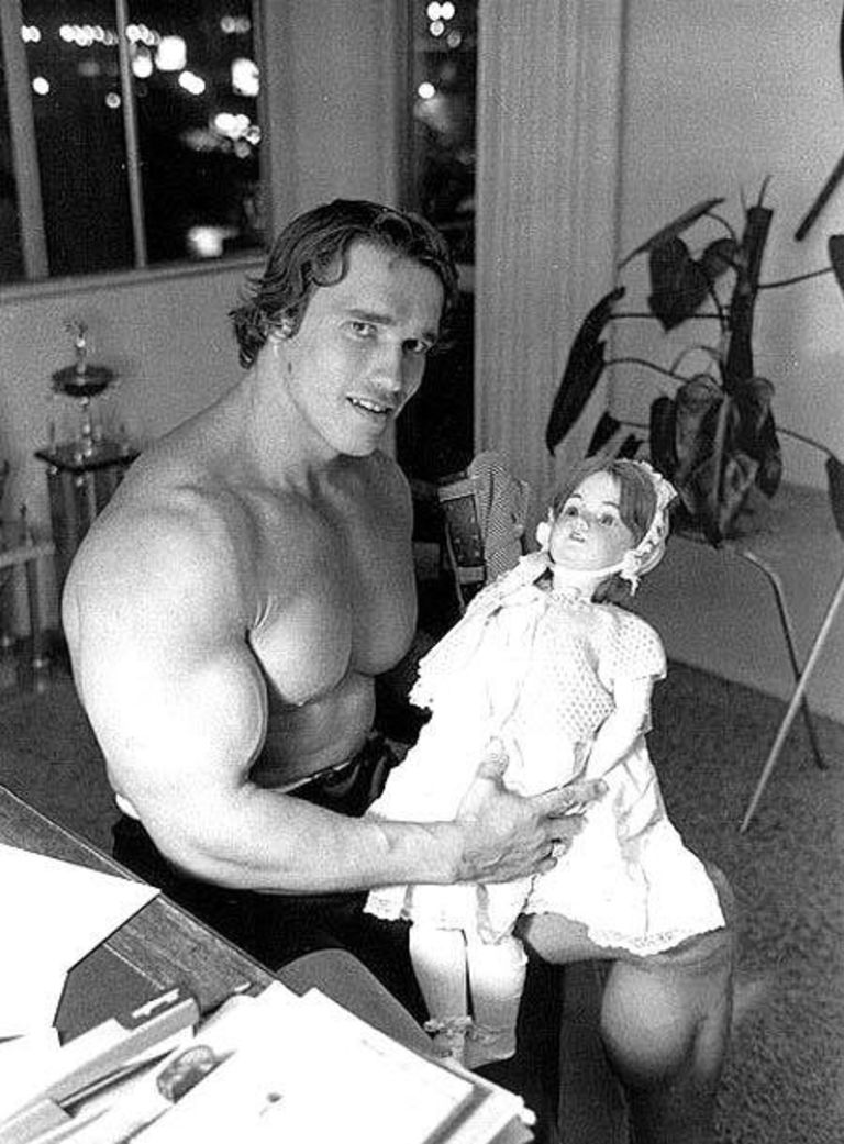 Arnold Schwarzenegger with a doll...
